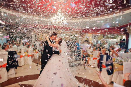 The first dance of newly married couple at their wedding party in restaurant.