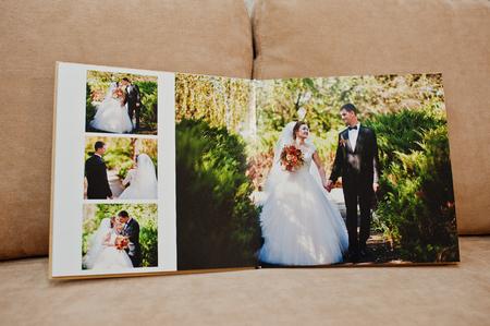 Pages Of Wedding Photobook Or Wedding Album On White Sofa ...