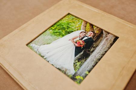 Elegant orange brown photobook or photo album on the sofa.