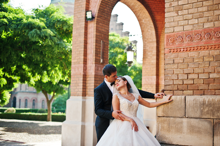 Stunning wedding couple enjoying each others company on a beautiful architectural background.