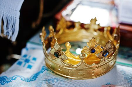 Close-up photo of crowns in the church meant for wedding ceremony. Stock Photo
