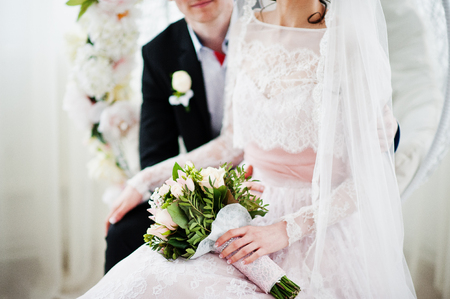 Close-up photo of a bouquet in brides hands.