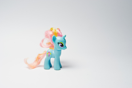 Hai, Ukraine - August 10, 2017: colorful toy pony from the famous cartoon My Little Pony on the white background.