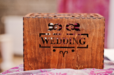 Close-up photo of a wooden brown box with inscription wedding. Stock Photo