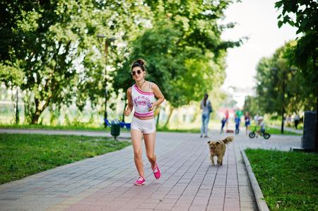 Sport girl wear on white shorts and shirt running at park.