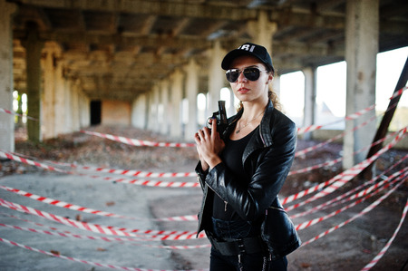 Sexy  female agent at abandoned place.
