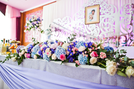 Floral compositions made of different flowers, decorated for the wedding celebration in the restaurant exclusively. Stock fotó