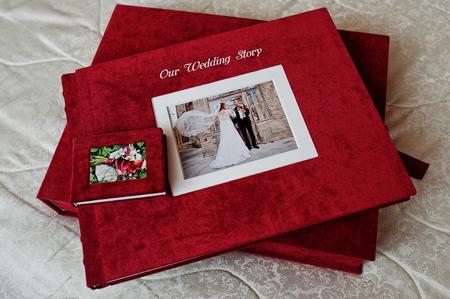 Elegant red velvet photobook of photo album on white background.