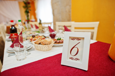 One of the wedding decorated tables with number on it. Imagens