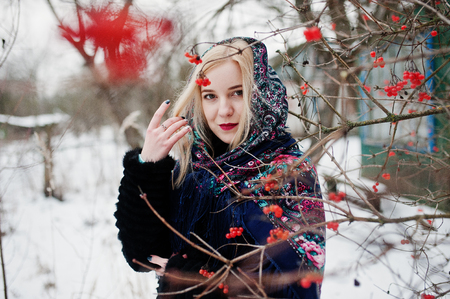 Blonde girl with hand embroidered scarf posed at winter day. Womens handkerchief. Stock Photo