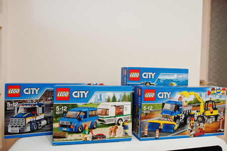 Hai, Ukraine - 08 January, 2017: close-up photo of LEGO City toys in packages for children of all age in the room.