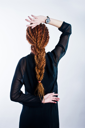 Studio shoot of back girl with dreads on white background.