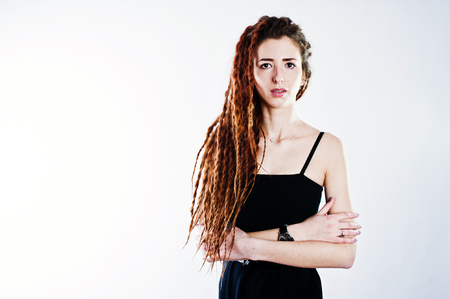 Studio shoot of girl in black with dreads on white background.