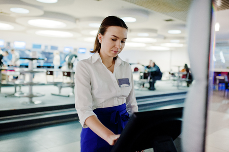 Waiter girl working with pos terminal or cashbox at cafe. People and service concept