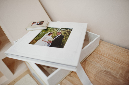 White and beige wedding book or album.