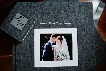 Elegant grey photo book or photo album and flash drive case on wooden stairs.