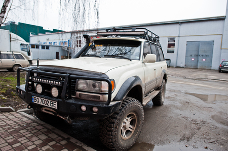 Hai, Ukraine - July 10, 2018: Aggressive dirty SUV on the parking lot. 報道画像