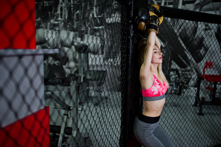 Sexy sport blonde girl boxer posed in the ring. Fit woman boxing. Stock Photo