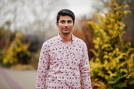 Indian man student at shirt posed outdoor.