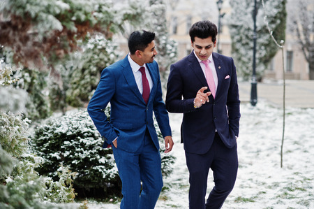 Two elegant indian fashionable mans model on suit posed at winter day.