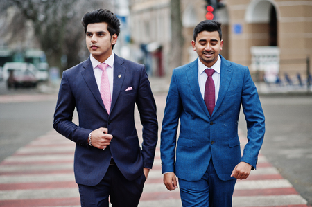 Two elegant indian fashionable mans model on suit walking at cross pedestrian. Stockfoto