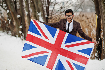 Stylish indian man in suit with Great Britain flag posed at winter day outdoor. Reklamní fotografie