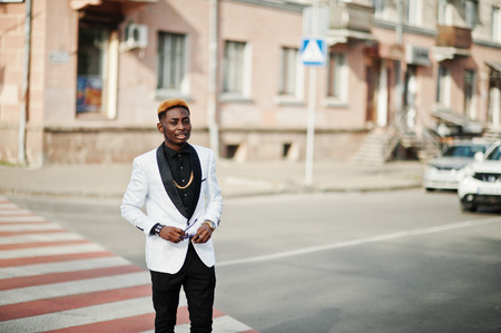 Chic handsome african american man in white suit walking on crosswalk. Stok Fotoğraf