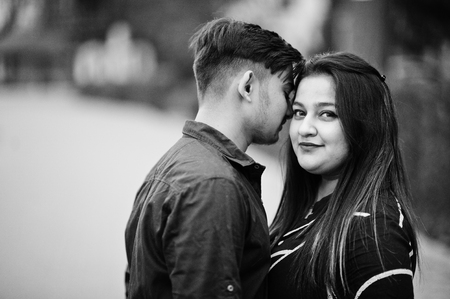 Love story of indian couple posed outdoor.