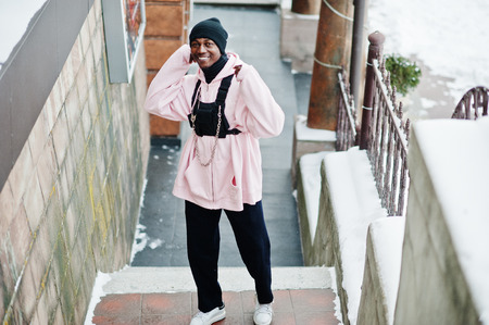 Stylish urban style african american man in pink hoodie posed at winter day.