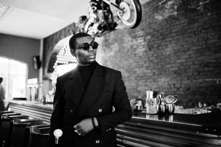 Stylish african american gentleman in elegant black jacket and sunglasses