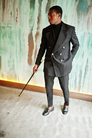 Stylish african american gentleman in elegant black jacket