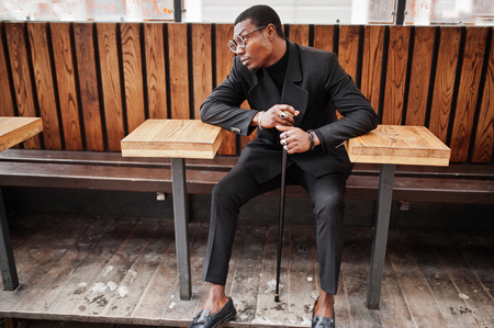 Stylish african american gentleman in elegant black jacket