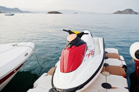 Red and whithe jet ski on a calm blue sea of Bodrum, Turkey. Фото со стока