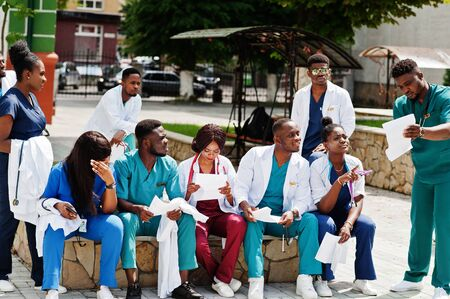 Group of african medical students posed outdoor prepare to exams. Stock Photo