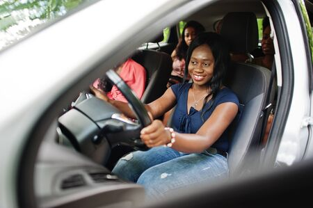 Group of african american girls friends having fun in the car.
