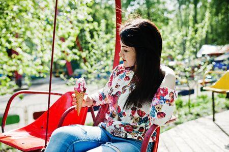 Brunette girl at amusement park. Imagens