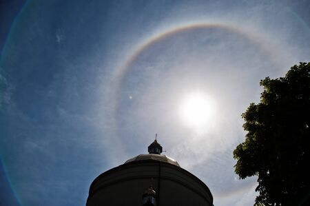Fantastic beautiful sun halo phenomenon up the church