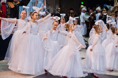Kyiv, Ukraine - September 1, 2019: Childrens angels in white dresses at Christmas event.