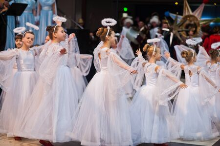 Kyiv, Ukraine - September 1, 2019: Childrens angels in white dresses at Christmas event. Éditoriale