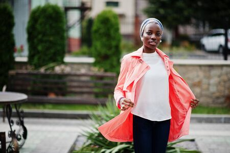 Young modern fashionable, attractive, tall and slim african muslim woman in hijab or turban head scarf posed.