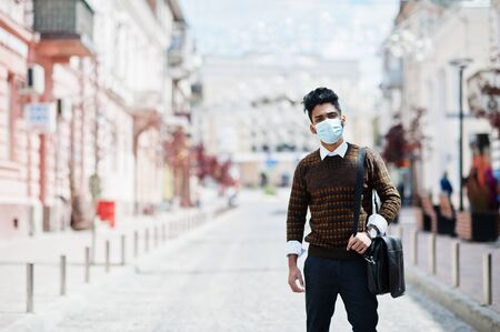 Coronavirus covid-19 concept. South asian indian man wearing mask for protect from corona virus.