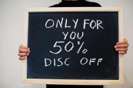 Only for you 50% disc off written on blackboard. Black friday concept. Boy hold board. Standard-Bild