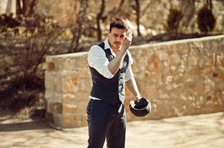 Portrait of retro 1920s english arabian business man wearing waistcoat.