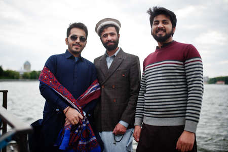Group of pakistani man wearing traditional clothes salwar kameez or kurta.