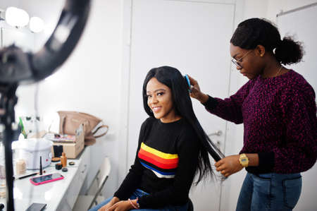 African American woman applying hairdresser or hairstylist at beauty saloon.