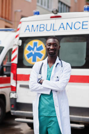 African male paramedic standing in front of ambulance car. Stok Fotoğraf