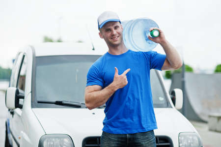 Delivery man in front cargo van delivering bottles of water showing finger.