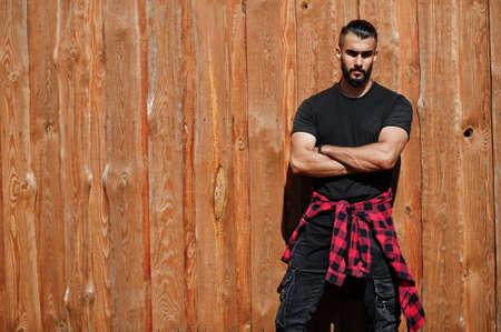 Arab hipster beard man lumberjack against wooden background.