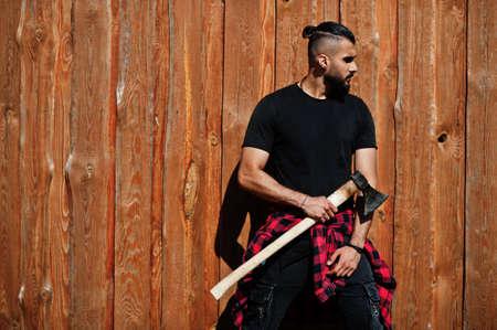 Arab hipster beard man lumberjack hold ax. Stock Photo