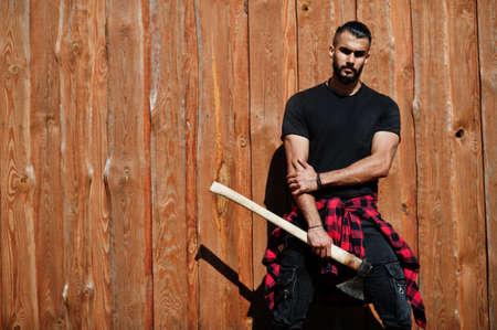 Arab hipster beard man lumberjack hold ax.